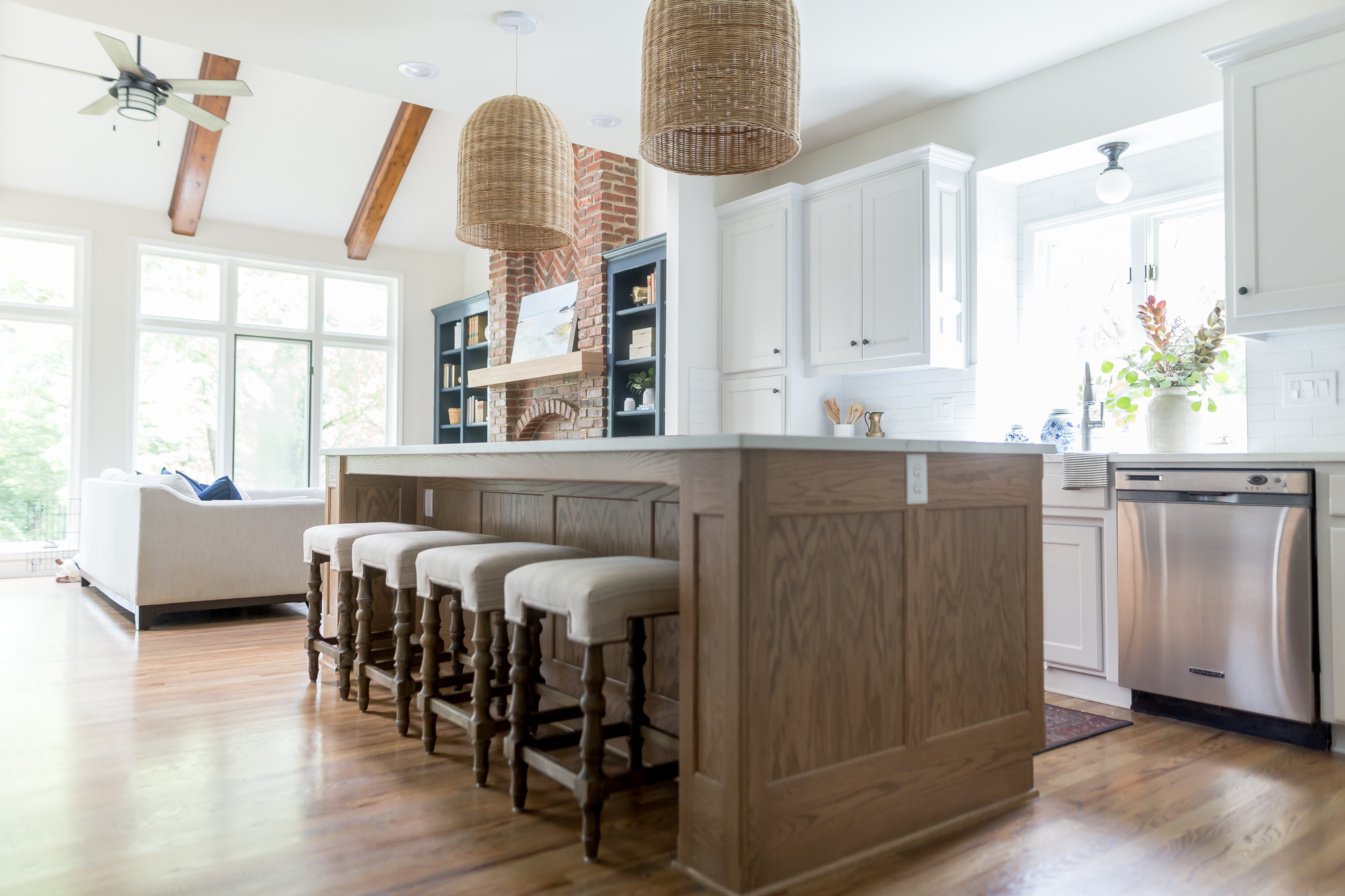 light gray cabinetry, Serena and Lily woven island pendants, counter stools