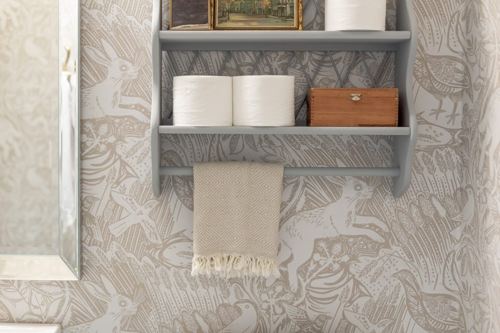 wallpapered powder bathroom blue antique wall shelf